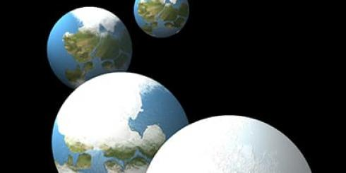 Earth progressing from green and blue to all white in a series of four globes