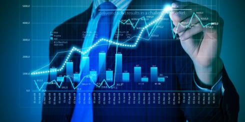 man in suit drawing stock chart