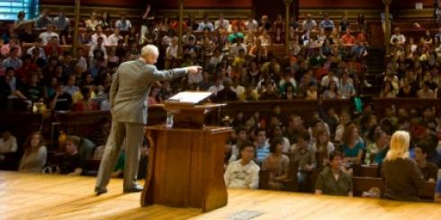 Professor Michael Sandel lecturing in front of hundreds of students at Sanders Theater, location of Justice course