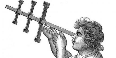 Person holding a Jacob's Staff, a device used to measure longitude.