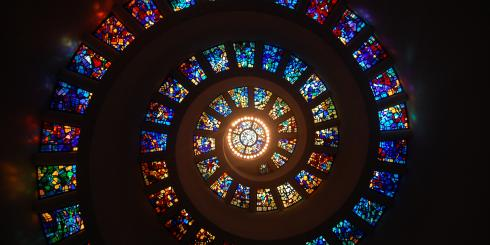 Stained glass windows arranged in a spiraling shape
