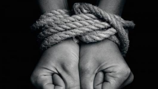 Hands tied with rope