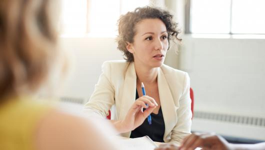 Woman discussing topic in meeting
