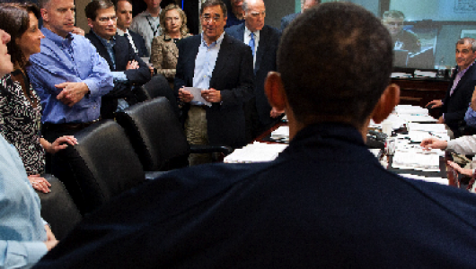 back of President Obama's head; table of male leaders around the table listening to him