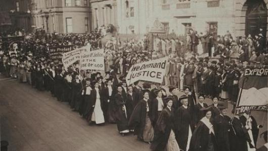 Women carrying signs in a protest march