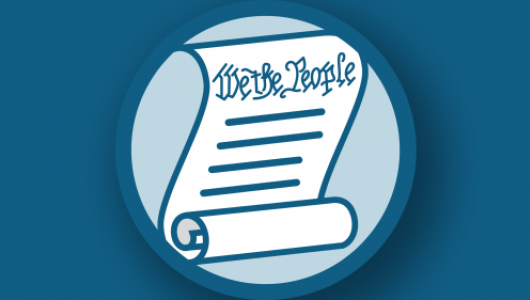 "Scroll with ""We the People"" written at the top"
