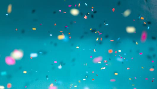 Colorful confetti against a blue background