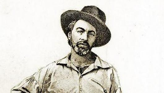 Etching of a young Walt Whitman with dark cowboy-type hat on